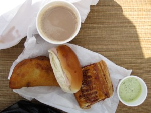Cafe con Leche, Empanada, Argentine sandwich, Guava Pastry, Arepa Dipping Sauce.  The croqueta is missing.