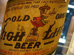 one of the first labels...anyone have an explanation for the High Life girl's outfit?