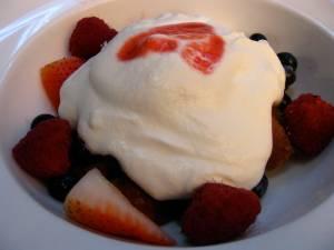simple dessert of berries and cream