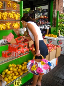 My Hawaiian friend Meleana, checking out fruit at Oahu Market, gets hitched on Saturday