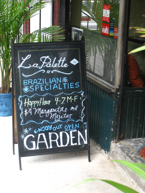 A Brazilian bar promoting their happy hour, one of many in the West Village alone