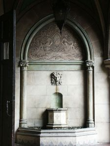 a gothic fountain detail on the way to the garden