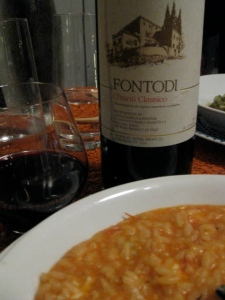 Wine, with a hearty tomato risotto with shredded basil and mozzarella