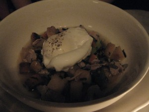 Rabbit soup with a poached egg