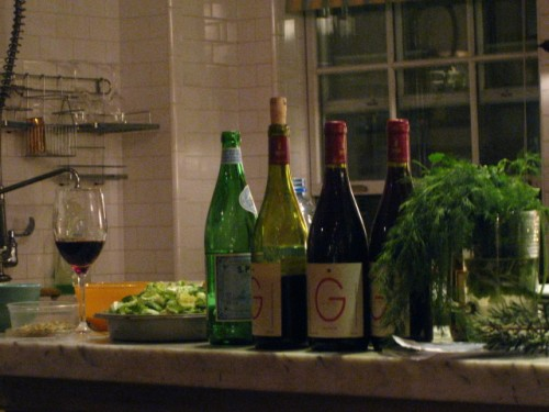 Wines and herbs on view in the open kitchen