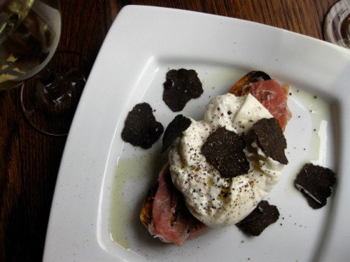 Burrata with shaved black truffles over crostini
