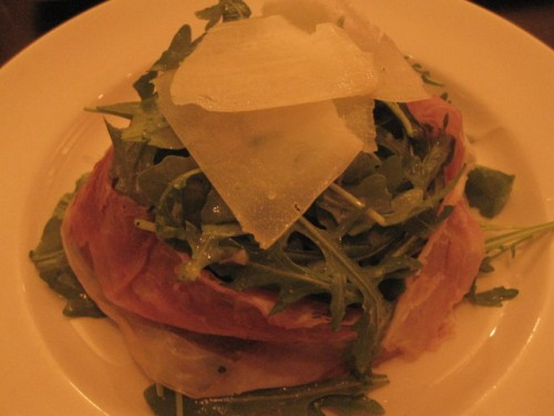 spicy arugula salad with proscuitto and shaved parmesan