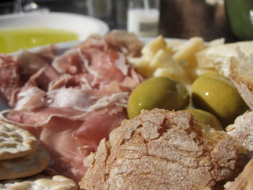 I sat in the sun and ate meat and cheese with hunks of crusty bread and olives