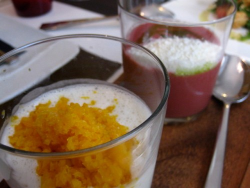 "Ajoblanco with ""frozen"" mango; on right, cherry gazpacho with basil oil and ""frozen"" goat cheese"